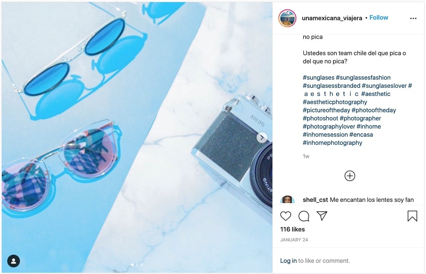 Instagram post with a photo of sunglasses and a camera with the hashtag #photography